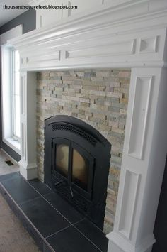 ledger stone fireplace surround; nice craftmanship on the arched top of the firebox