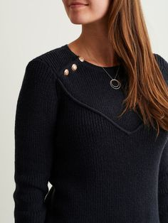 Button details on this knit top