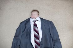 Business Baby...Hilarious!!!  Reminds me the head shrinking dust from Beetlejuice.