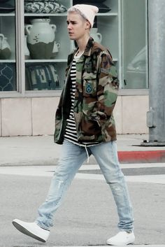 He FREAKING looks like he is modeling when he's just walkin g