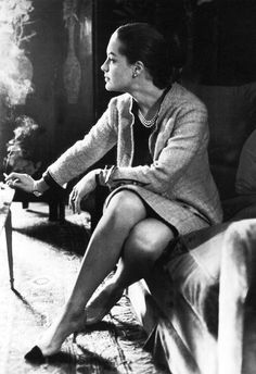 Romy Schneider wearing Chanel, in the living room of Madame Coco's apartment on the Rue Cambon, Paris, 1960