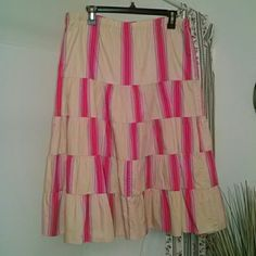 """Tan & Pink Low Waist Tiered Peasant Skirt Pretty skirt by Old Navy.  Main color is tan and the stripe designs are various shades of pink.  Low waist, meant to be worn closer to the hips.  Size medium but could possibly fit a large.  I'm 5'4"""" and it hits above my ankle.  Ask if you need measurements!  Only worn a couple of times.  In great condition. Old Navy Skirts"""
