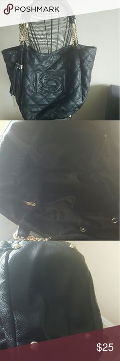 Bebe Shoulder bag Black quilted shoulder bag. Gently used with gold hardware. Includes gold bag feet on the bottom which helps preserve the life of the bag. The shoulder straps show signs of normal wear and tear (pictured above) but this bag is stylish and still has a lot of life left in it. As always I am open to questions and reasonable offers. bebe Bags Shoulder Bags