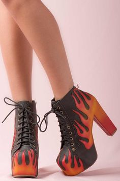 https://www.cityblis.com/5911/item/15511  JEFFREY CAMPBELL LITA BOOTS in Red and Black Flames - $265 by Jeffrey Campbell  Lita Boots in Red and Black Flames By Jeffrey Campbell   Lace up platform boots, metal eyelets, tonal laces, smooth leather upper with handpainted contrast red and black flames detail throughout,   13cm heel with 5cm platform.