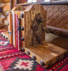 A bookshelf inside Bear House luxury accommodation at The Ranch at Rock Creek in southwest Montana. This Forbes Travel Guide Five-Star guest ranch is full of details that highlight The Ranch's historic homestead and rich history. Jet Zarkadas designed the living spaces with textiles, antiques and unique decor. Each of the 29 accommodations is one-of-a-kind.