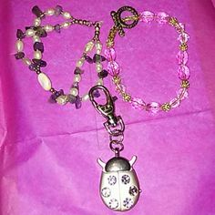 Two bracelets and One locket watch The ladybug locket watch needs a battery and has few scratches on the front, it can be used as decoration. The purple bead bracelet is sized small and is rarely worn. The pink bracelet is home made and elastic so it is good for all sizes. Jewelry Bracelets