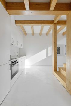 Despite stone walls this project really shows a genius way of using wood as a structural element while also giving an aesthetic value to the interior. /  Portugal interior wood design and architecture
