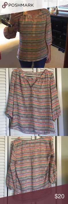 """Banana Republic 3/4 sleeve Henley. Multicolored Henley with 3/4 sleeves. Flows fit and covers hips (I'm 5'6""""). Fun top to throw on and still look like you put a little effort into your look! Perfect for Texas fall or spring! Small snags in front...hard to notice bc of the pattern. Banana Republic Tops Blouses"""