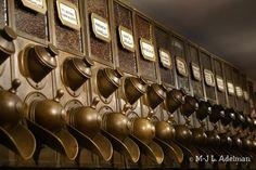 A row of 14 brass, coffee bean dispensers photographed in a city coffee shop. Coffee Bean Shop, Coffee Bean Candle, Coffee Bean Art, Nyc Coffee Shop, Coffee Store, Coffee Shop Design, Coffee Display, Starting A Coffee Shop, Coffee Dispenser