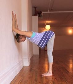Shoulder Opener at Wall | 8 Yoga Poses To Help Cervical Spine & Neck Issues. Place your forearms on the wall parallel to one another below shoulder height, keeping your elbows shoulder-distance apart. Take a few steps back from the wall and allow your head to relax down between your arms. Breathe here for five deep breaths.