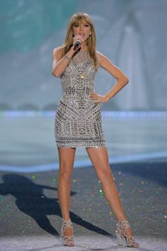 Taylor Swift performing at the 2013 Victoria's Secret Fashion Show. See all of the singer's best looks.