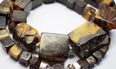 From Poland, a 190g  Natural square cut Baltic amber necklace with natural inclusions. From Amberlovers on Etsy.