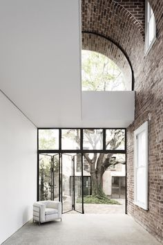 The Italianate House by Renato D'Ettorre Architects is a large addition and alterations project with 4 main components – the Italianate Terrace House for the family, the historic sandstone stables as guest quarters, the new concrete carport with landscaped roof terrace along with the gardens and the swimming pool.
