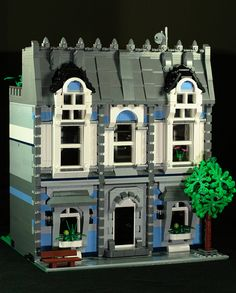 So many things about this. Roofing, door, moldings, windows, tree. This is awesome