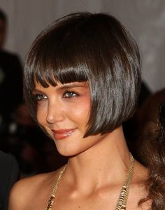 Short bob with bangs, love it, but my hair will NEVER be that straight....