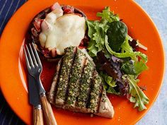 Rachael's grilled tuna steaks are coated in tasty herbs that give the fish an aromatic crust while it cooks. She adds grilled portobello mushrooms on the side to perfectly round out this rustic summer meal.