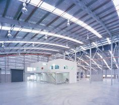 Boat factory with wave like roof design