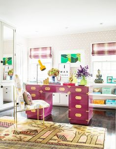 Home office with purple desk and lots of colorful pieces