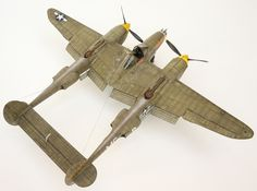 P-38 from Hasegawa; detailed with Aires cockpit, Eduard photo-etch, True Details wheels, Paragon flaps and several Quickboost items. Decals from Aeromaster.