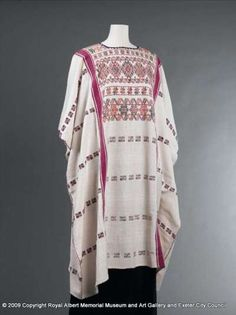A traditional plain woven lady's blouse made from three lengths on a backstrap loom from hand-spun cotton. It displays a wealth of brocaded patterning worked with commercial thread. Lengths are joined by decorative stitching. From Mexico.