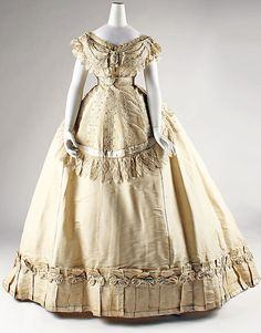Dress, Evening  Date: ca. 1867 Culture: French Medium: silk Dimensions: [no dimensions available] Credit Line: Gift of Art Worker's Club, 1945 Accession Number: C.I.45.68.8a–c