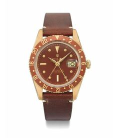 Rolex GMT Master #6542 in 18k yellow gold with a brown dial and bezel insert, circa late 1950's.