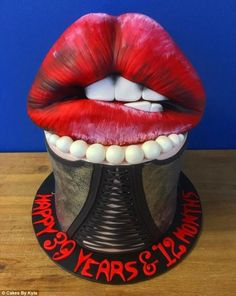 An ode to the Rocky Horror Picture Show, this Dr Frank 'N' Furter cake is complete with corset designs and red lips