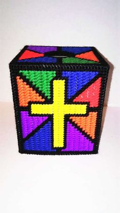 A personal favorite from my Etsy shop https://www.etsy.com/listing/462169498/stained-glass-cross-tissue-box-cover