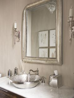Carrera Marble Vanity With A Hammered Silver Sink Silver Faucet - White and silver bathroom ideas