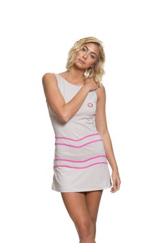 Alethia Tennis Dress Grey and Pink. Available on our website:                                                                          www.30Fifteen.co.uk 30Fifteen | Tennis | Fitness | Health | Fashion