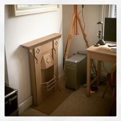 What should I do with all the IKEA boxes I have left over... Cardboard fireplace obviously!   by Finger in the Pie