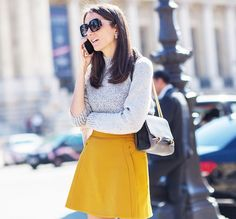 Style a simple knit with a mustard miniskirt for a fall mod look. // #StreetStyle