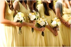 lemon yellow bridesmaids for a french inspired wedding in Utah at a french restaurant garden.