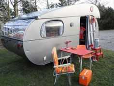 Retro trailer.  If we camped more than 2 times a year, I would so want something like this.