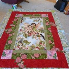 My granddaughter got a pull to fairies, she had pictures, fairie dolls, anything that had a fairy on it she had it.  So Oma and I (Opa) made her a fairy quilt made with a center panel of Cicely Mary Barker. It was a way to get it made fast and beautiful.   Hope you like my presentation.