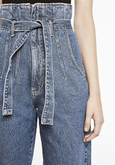 The Wide Leg Jean features a paperbag style waistline, belt loops with self covered tie belt, front and back pockets, wide leg with cropped cuffs and YKK zip closure.Fabric Content: 100% Cotton