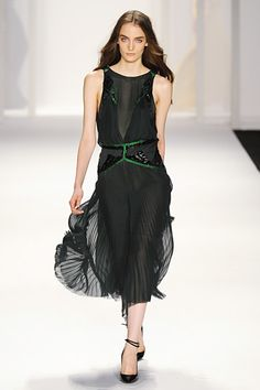Love the green accents on this dress.  #JMendel #NYFW