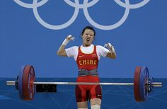 Wang Mingjuan of China competes during the women's 48kg weightlifting competition at the 2012 Summer Olympics, Saturday, July 28, 2012, in London. Wang won the gold medal. (AP Photo/Hassan Ammar)