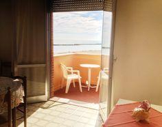 ogni appartamento dispone di balconi con tavolino e sedie, così potrete comodamente guardare il mare dal vostro appartamento, magari al sorgere del sole o  in una bella serata d'estate o per rigenerarvi semplicemente al fresco della brezza del mare, dopo una giornata in spiaggia ..