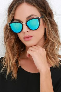 Sunshine on a cloudy day? No worries, just put on the Quay My Girl Blue and Black Sunglasses! These shades boast an ultra-chic look with a slight cat-eye and a flick of silver trim highlighting the matte black frames. Mirrored blue lenses. Protective case included. 100% UV protection.