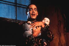 """Twin sisters Kaitlyn and Kristen Hooper both shared the role of Pubert -- the adorable moustached baby -- in the 1993 comedy """"Addams Family Values."""" Guess what they look like now! Adams Family Baby, Raul Julia, Addams Family Values, Group Pictures, Movie Costumes, Twin Sisters, Tv On The Radio, Movie Characters, Vintage Movies"""