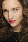 Gorgeous matte magenta lips were offset by a flawless complexion at DVF