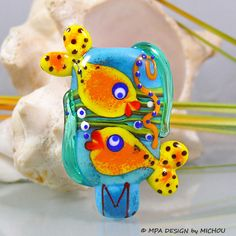 OMG.. I love that the fish fins are coming out of the bead... it's a dot bead and a sculptural bead in one.