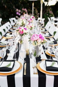 Black white gold and pink wedding table setting