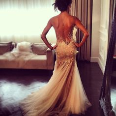 Backless gold wedding dress. WANT. if it were in white, it'd actually be perf for a wedding