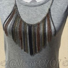 Dressy tank with removable chain Ladies tank top with removable necklace with multi color metals silver, black, copper, and gray. 95% Rayon 5% Spandex in size Petite Large Cha cha vente Tops Tank Tops