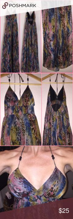 Animal print watercolor maxi Love this gorgeous watercolor maxi dress with cheetah and snake skin print. Beautiful colors ranging from pink blue to yellow this dress has a black slip underneath and wood bead detail on the halter straps. GORGEOUS!!! TCEC Dresses Maxi