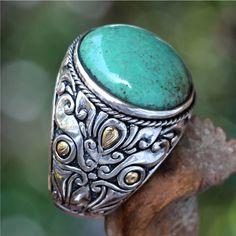 <ul><li>Turquoise accent ring</li><li>Sterling silver jewelry</li><li><a href='http://www.overstock.com/downloads/pdf/2010_RingSizing.pdf'><span class='links'>Click here for ring sizing guide</span></a></li></ul>