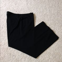 "NWOT, Ralph Lauren Black Dress Pants NWOT, Ralph Lauren, Beautiful black dress pants. A truly perfect fit! Belt loops, double hook and button hidden front zip closure. Flat front with 2 back button closure pockets. Beautiful material made of 63% polyester, 33% viscose & 5% elastase. Inseam measures 32.5"", size 16. Brand new, never worn. Ralph Lauren Pants Trousers"