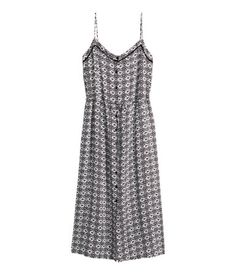 Knee-length dress in airy woven fabric with a printed pattern. Narrow, adjustable shoulder straps, hem-stitch embroidery at top, and removable tie belt at waist.  $15